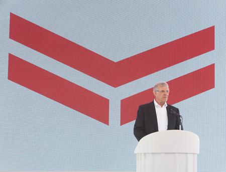 Ted Bregar, Yanmar America president, presenting new logo